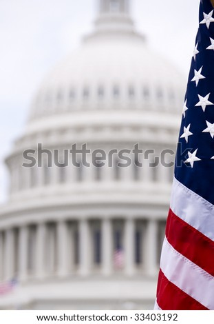 An american flag, shown in front of the Capitol building dome. - stock photo