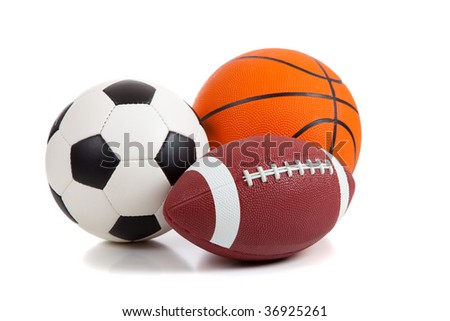 An american football, a soccer ball and a basketball on a white background