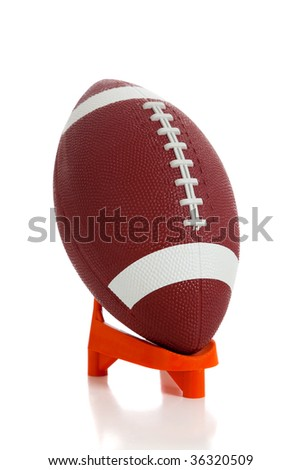 An American football and tee on white background - stock photo