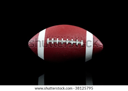 An American football on black background with copy space - stock photo