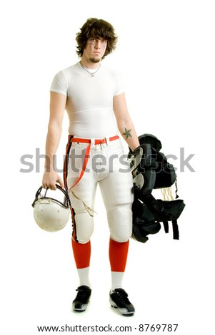 An American football player. Standing with helmet and pads.