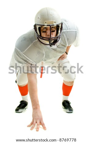 An American football player. Three point stance. - stock photo