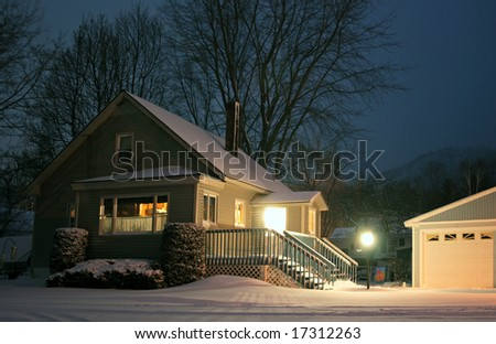 An american home at night during winter. - stock photo