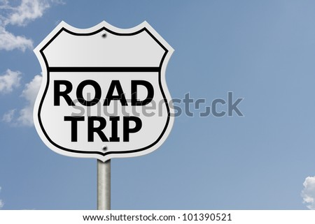 An American interstate road sign with words Road Trip with sky background, Taking a Road Trip - stock photo