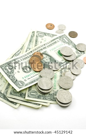 An American one dollar bill and several different American coins isolated on a white background. - stock photo