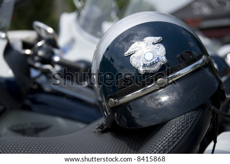 An American police helmet on the saddle of a motorcycle. - stock photo