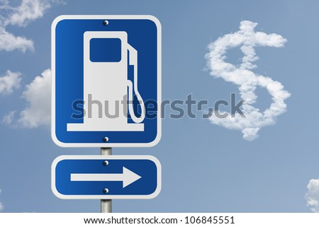 An American road sign with gas symbol, arrow, and dollar sign in the clouds, The price of gas - stock photo