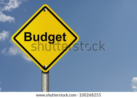An American road sign with sky background and copy space for your message, Warning about your budget - stock photo
