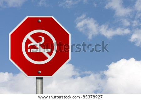 An American road stop sign and no smoking symbol with sky background and copy space for your message, Stop Smoking Sign