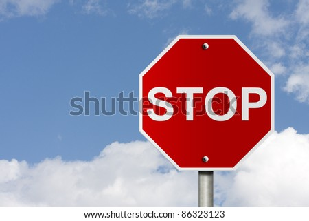 An American road stop sign with sky background and copy space for your message