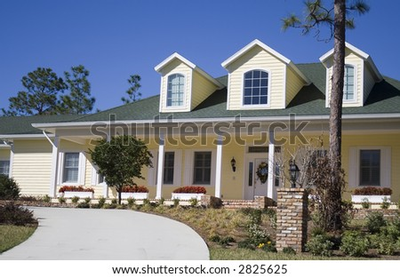 An American suburb residential home - traditional style with porch and flower boxes. - stock photo