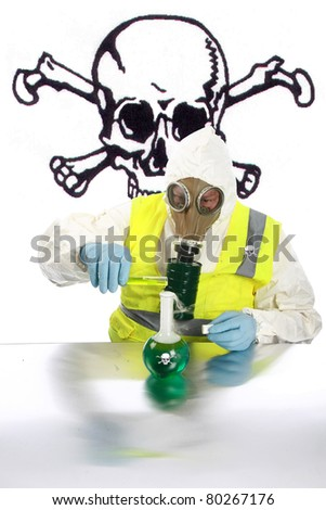 an Anarchist wearing a hazmat suit, gloves and gas mask mixes dangerous chemicals together in a lab in preparation for expected up coming mayhem with room for your text. - stock photo