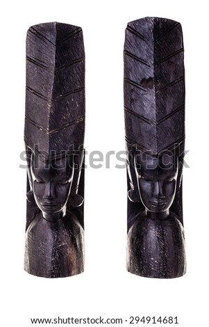 an ancient african black wood carved artifact isolated over a white background - stock photo