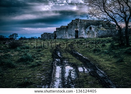 an ancient and abandoned rural house in Italy - stock photo