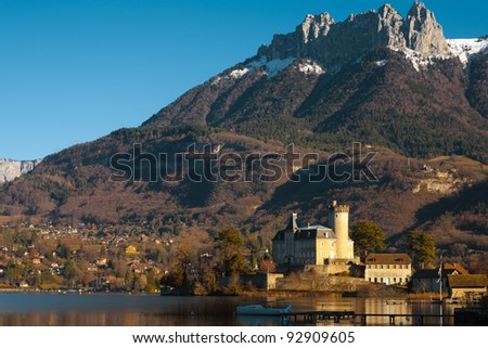 An ancient castle at the foot of the Alps in Duingt, France - stock photo