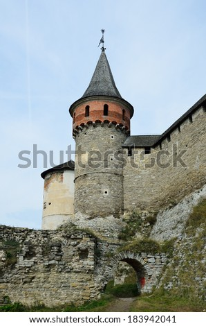 An ancient castle dominates on the green rock above the famous Ukrainian town Kamianets-Podolsky. - stock photo