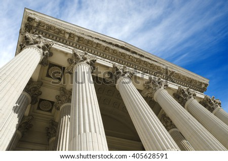 an ancient courthouse on a blue stunning sky - stock photo