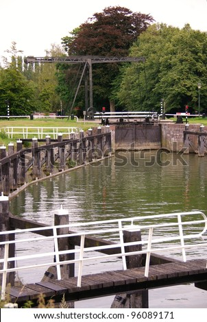 An ancient draw bridge in the old locks complex in Zwolle in the Netherlands - stock photo