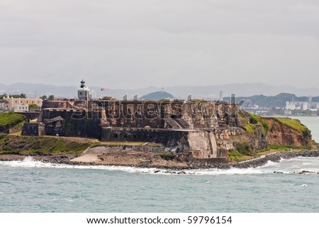 An ancient fort over a point of land on the coat of Puerto Rico - stock photo