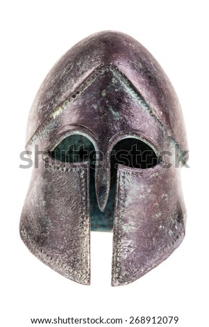 an ancient greek war helmet isolated over a white background - stock photo