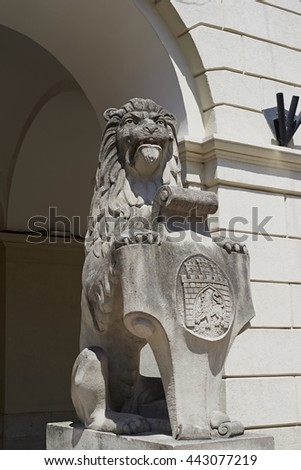 "An ancient Lions' statue in front of Lviv Town Hall on the Market Square ""Rynok"" in Lviv, Ukraine"