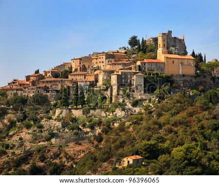 An ancient medieval village built on a steep hillside in southern France. - stock photo