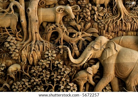 An ancient mural wood carving from Thailand. - stock photo