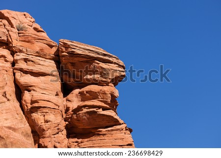 An ancient orange sandstone wall inside of Canyon X located in Page, Arizona. - stock photo