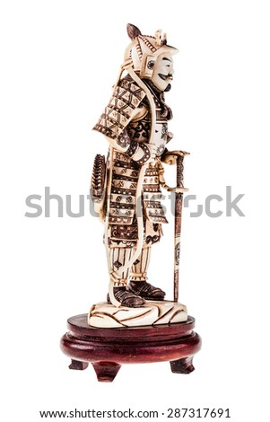 an ancient precious ivory japanese samurai warrior figurine isolated over a white background - stock photo