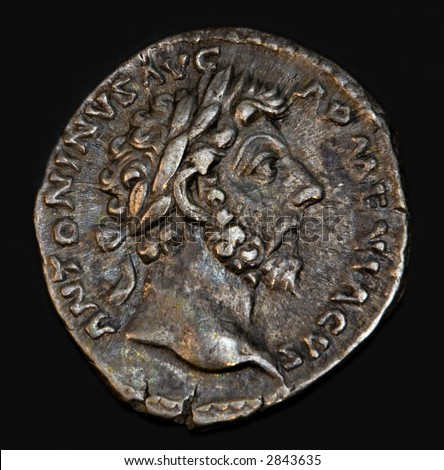 An Ancient Roman Coin With Emperor Antoninus - stock photo