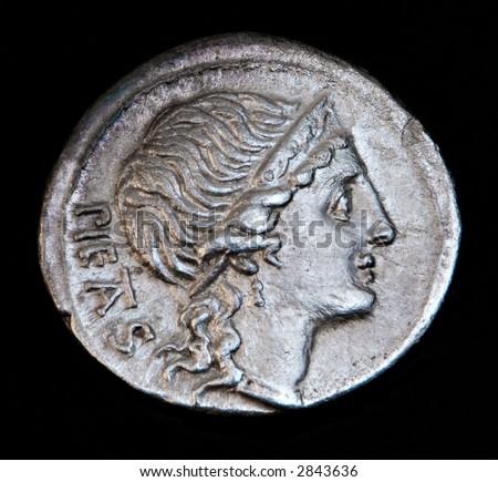 An Ancient Roman Coin With Pietas Head - stock photo