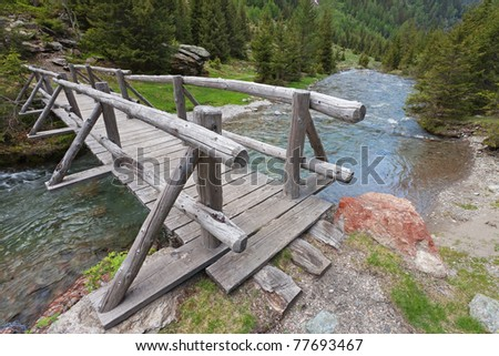 An ancient wooden bridge - stock photo