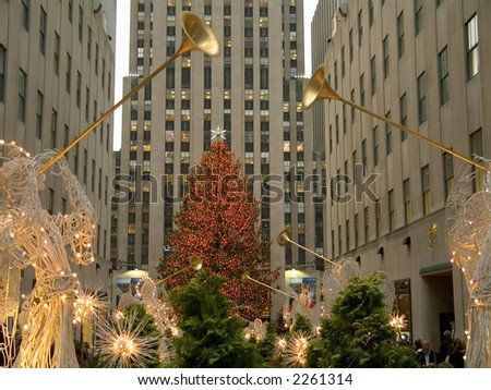 An angel decoration and colorful lights frame the Christmas tree at Rockefeller Center in Manhattan.