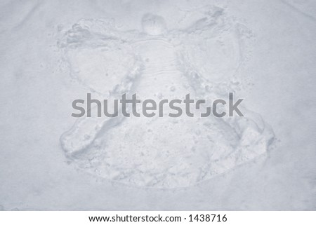 an angel in the snow - stock photo