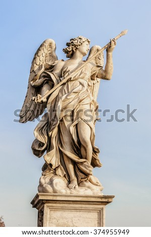 An angel statue close to the Castel Sant Angelo situated in the Italian capital of Rome. - stock photo