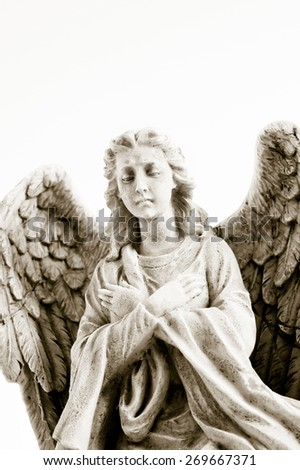 an angel statue in light marble, isolated - stock photo