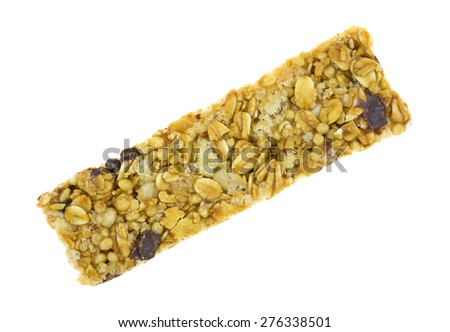 An angle view of a single granola bar on a white background. - stock photo