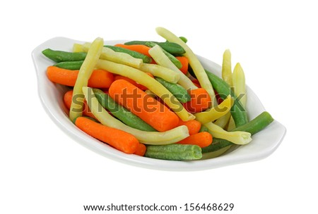 An angle view of whole vegetables in a serving dish. - stock photo