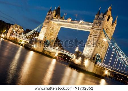 An angled shot of Tower Bridge, floodlit - stock photo