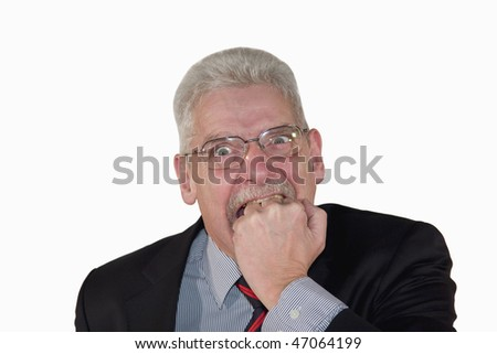 an angry and frustrated caucasian senior manager biting into his fist, isolated on white background