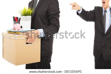 An angry boss firing a man and carrying belongings - stock photo