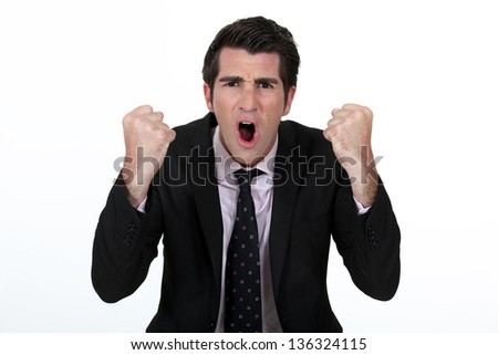 An angry businessman - stock photo
