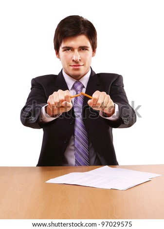 An angry businessman breaking a pencil, isolated on white - stock photo