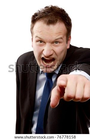 An angry businessman pointing at you - stock photo