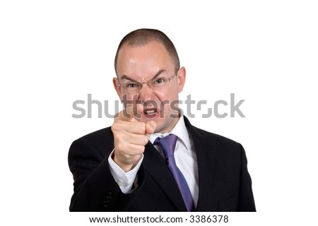 An angry businessman points and shouts - stock photo