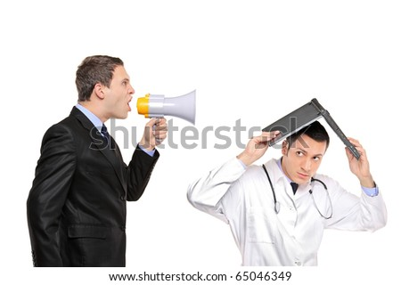 An angry businessman yelling via megaphone to a doctor isolated against white background - stock photo