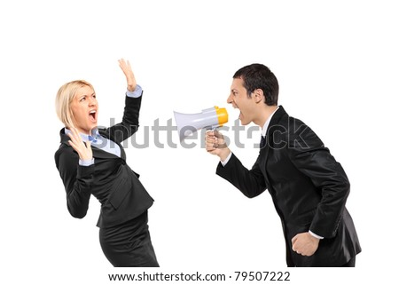 An angry businessman yelling via megaphone to a scared businesswoman isolated on white background - stock photo