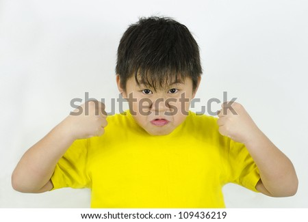 an angry child showing his temper and fists
