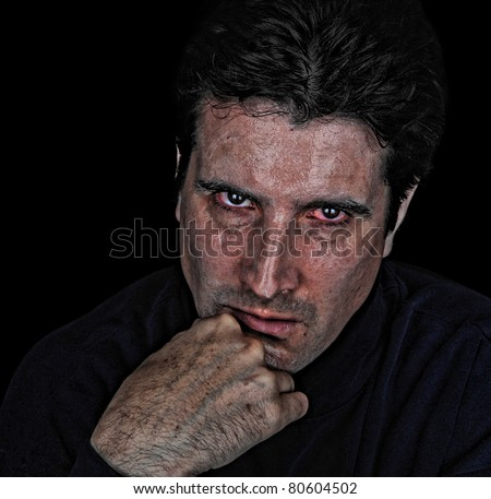 An angry, violent and evil man glares intently at his next victim. - stock photo