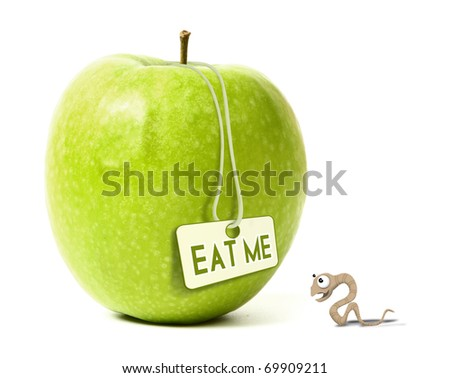 An angry worm looking a big green apple - stock photo